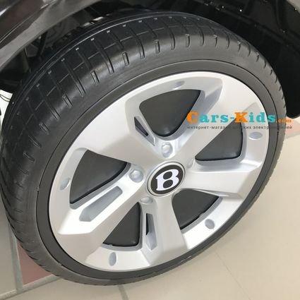Электромобиль Bentley Bentayga черный (колеса резина, кресло кожа, пульт, музыка, глянец)