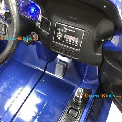 Электромобиль Volkswagen Touareg синий (колеса резина, кресло кожа, пульт, музыка)